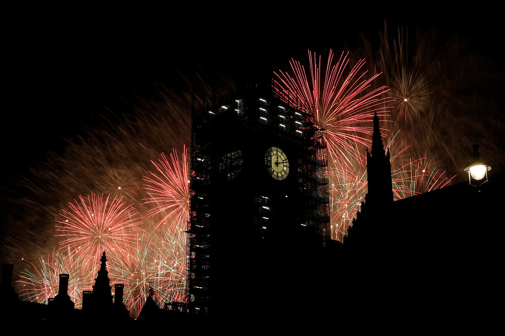 ". Fireworks explode over the River Thames behind the Elizabeth Tower which contains the bell known as ""Big Ben\"", at the Houses of Parliament in London, as New Year\'s celebrations take place after midnight, Monday, Jan. 1, 2018. Scaffolding stands erected around the Elizabeth Tower for repairs, with the last extensive conservation works taking place more than 30 years ago. (AP Photo/Matt Dunham)"