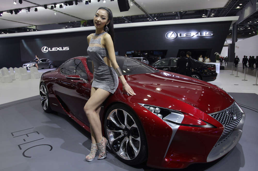 . A Model poses next to a Lexus LF-LC Hybrid Sport Coupe Concept at the Seoul Motor Show 2013 on March 28, 2013 in Goyang, South Korea. The Seoul Motor Show 2013 will be held in March 29-April 7, featuring state-of-the-art technologies and concept cars from global automakers. The show is its ninth since the first one was held in 1995. About 384 companies from 14 countries, including auto parts manufacturers and tire makers, will set up booths to showcase trends in their respective industries, and to promote their latest products during the show.  (Photo by Chung Sung-Jun/Getty Images)