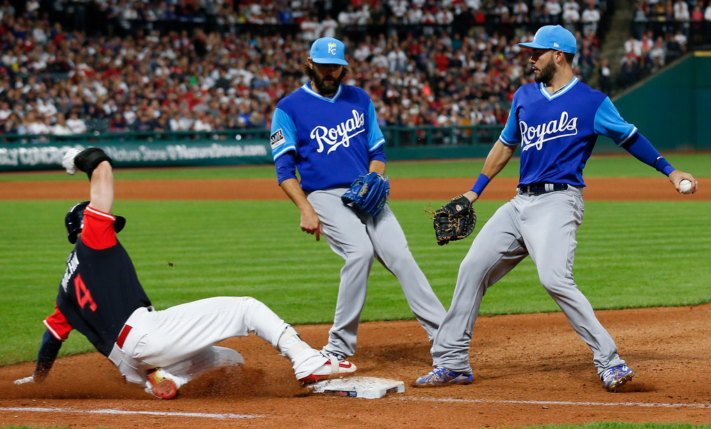 . Cleveland Indians\' Bradley Zimmer (4) beats Kansas City Royals\' Eric Hosmer to first base for an infield single as Kansas City Royals starting pitcher Jason Hammel, center, looks on during the seventh inning in a baseball game, Saturday, Aug. 26, 2017, in Cleveland. (AP Photo/Ron Schwane)