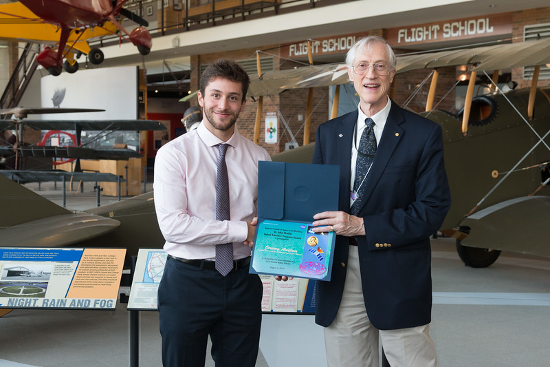 "Jeremy Auclair with John Mather, in front of Curtiss Jenny JN-4 -- An award luncheon, ""Dr. John Mather Nobel Scholars Program Award"", as part of the National Space Grant Foundation. College Park Aviation Museum, College Park, MD, August 2, 2019."