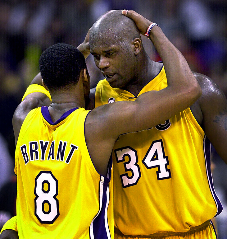 """. FILE-This April 21, 2002 file photo shows Los Angeles Lakers\'s Kobe Bryant, left, and Shaquille O\'Neal embracing in the closing minutes in Game 1 of their best-of-five first-round Western Conference playoff series against the Portland Trail Blazers in Los Angeles.  O\'Neal says on Twitter  Wednesday June 1, 2011,that he\'s \""""about to retire.\"""" O\'Neal sent a Tweet shortly before 2:45 p.m. saying, \""""im retiring.\"""" It included a link to a 16-second video in which he says, \""""We did it; 19 years, baby. Thank you very much. That\'s why I\'m telling you first: I\'m about to retire. Love you. Talk to you soon.\"""" (AP Photo/Mark J. Terrill,File)"""