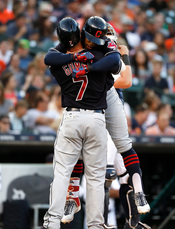 . Cleveland Indians\' Francisco Lindor celebrates his two-run home run against the Detroit Tigers with Yan Gomes (7) in the fifth inning of a baseball game in Detroit, Friday, July 27, 2018. (AP Photo/Paul Sancya)