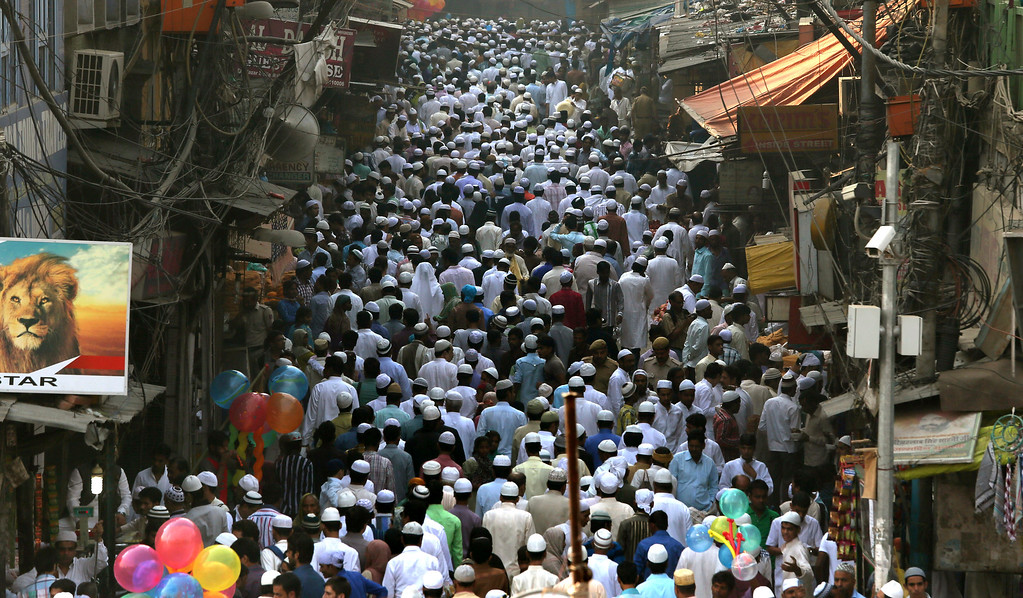. Indian Muslims leave after offering prayers on Eid al-Adha at the Jama Mosque in New Delhi, India, Wednesday, Oct. 16, 2013.  (AP Photo/Manish Swarup)