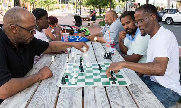 06/29/18 Wesley Bunnell | Staff Bruce Young, L, and Harley Maddox play chess on Friday afternoon in Central Park.
