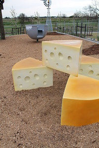 cheese sculpture and milk agitator spinner