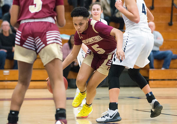 02/13/20 Wesley Bunnell | StaffrrNewington girls basketball defeated New Britain at home Thursday evening. New Britain's Raven-Symone Jarrett (5).
