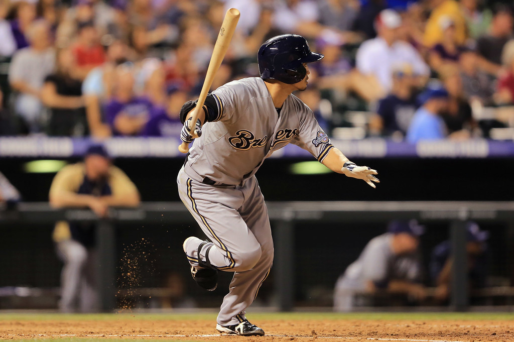 . DENVER, CO - JULY 26:  Norichika Aoki #7 of the Milwaukee Brewers hits an RBI single to score Rickie Weeks #23 of the Milwaukee Brewers against the Colorado Rockies in the sixth inning at Coors Field on July 26, 2013 in Denver, Colorado.  (Photo by Doug Pensinger/Getty Images)