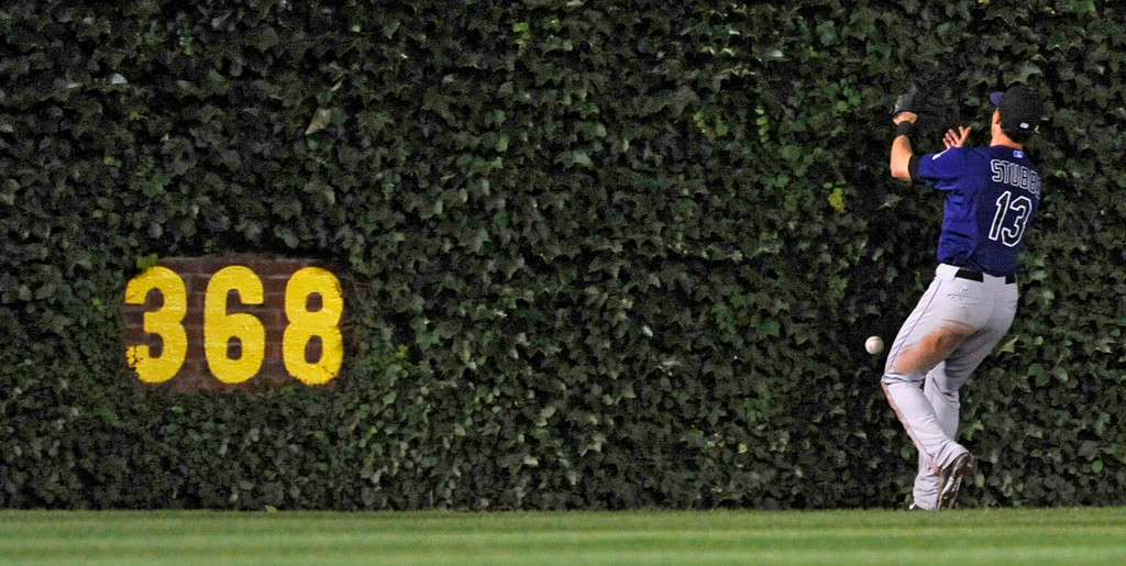 . Colorado Rockies center fielder Drew Stubbs drops a fly ball hit by Chicago Cubs\' Starlin Castro during the eighth inning of a baseball game in Chicago, Wednesday, July 30, 2014. (AP Photo/Paul Beaty)