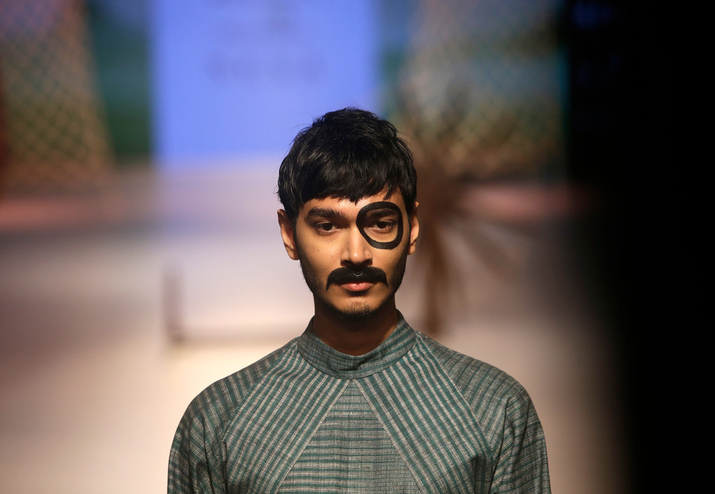 . A model walks the ramp to showcase the creation of designer Jewellyn Alvares during Lakme fashion week winter 2018 in Mumbai, India, Thursday, Aug. 23, 2018. (AP Photo/Rajanish Kakade)