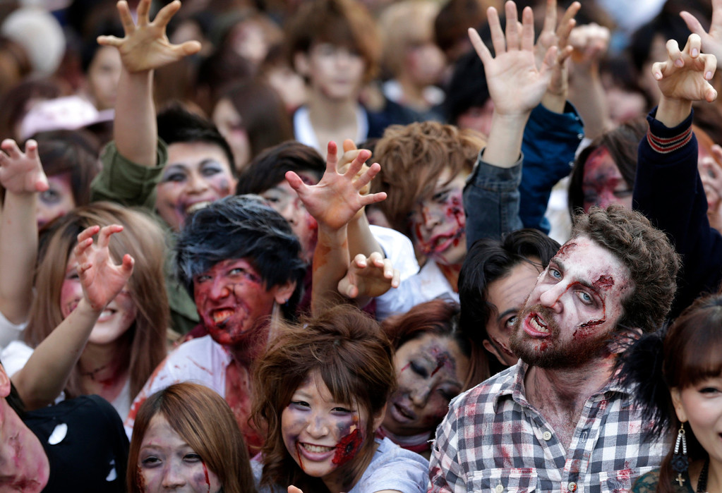 . Participants in zombie costumes, perform during a Halloween event at Tokyo Tower in Tokyo, Thursday, Oct. 31, 2013. (AP Photo/Shizuo Kambayashi)