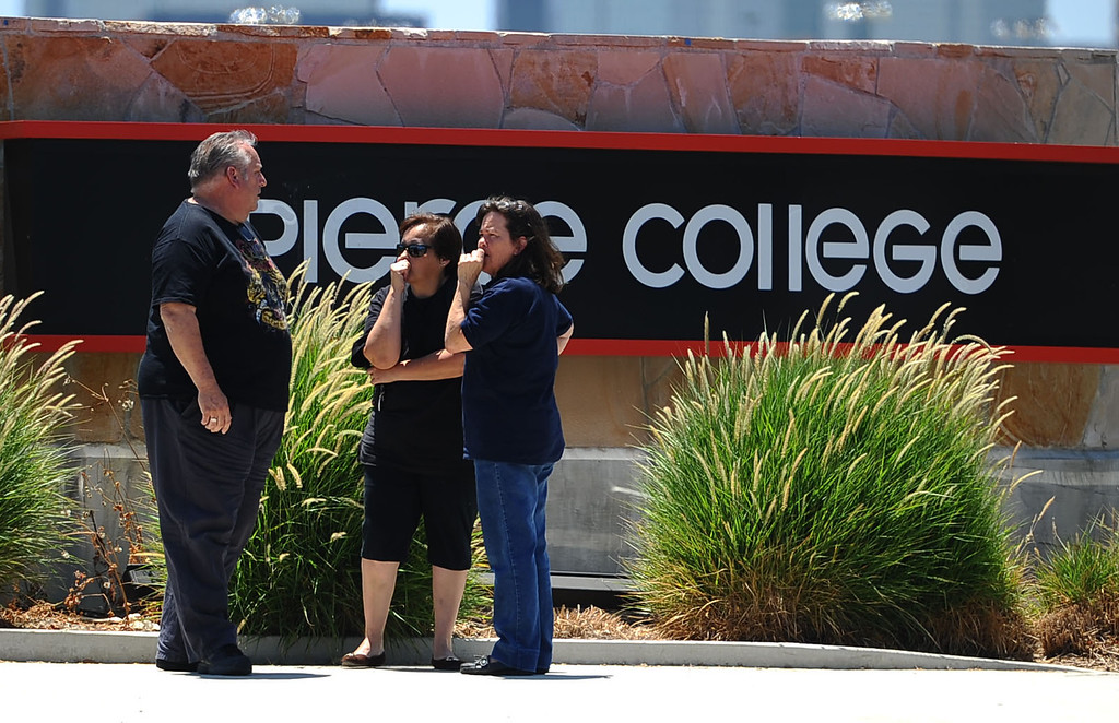 . People gather near a Pierce College entrance May 30, 2014 in Woodland Hills.  A report of a suicidal man with a gun on campus created a lockdown situiation around noon.  The man was later found at Canoga Bowl.(Andy Holzman/Los Angeles Daily News)