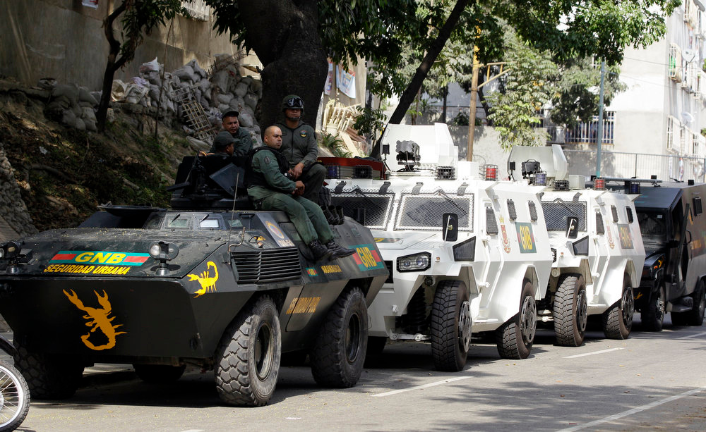 . Venezuelan National Guard soldiers and vehicles sit along a street near downtown Caracas, Venezuela, Monday, April 15, 2013. Venezuela\'s government-friendly electoral council indicated Monday it would quickly certify the presidential victory of Hugo Chavez\' hand-picked successor Nicolas Maduro, apparently ignoring opposition demands for a recount in Sunday\'s tight race. (AP Photo/Fernando Llano)