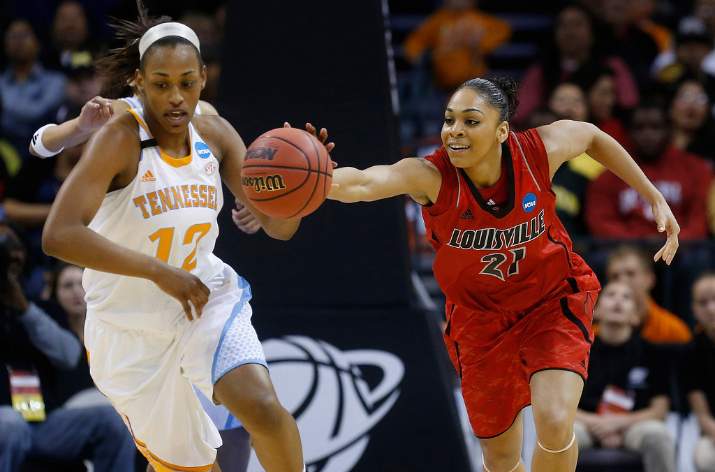 . Louisville guard Bria Smith (21) reaches for the ball in front of Tennessee forward Bashaara Graves (12) in the first half of the Oklahoma City regional final n the NCAA women\'s college basketball tournament in Oklahoma City, Tuesday, April 2, 2013.  (AP Photo/Sue Ogrocki)