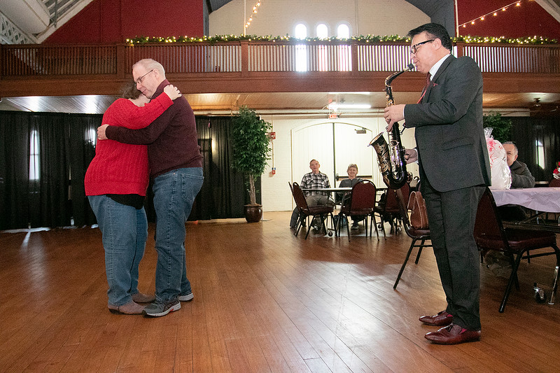 """The talent of jazz virtuoso, Clyde Wheatley from Holden entertained the crowd at the Fitchburg Senior Center's """"Be My Valentine"""" on Wednesday morning for some romance, love and all the classics. He played the clarinet, the alto saxophone and the soprano saxophone for the crowd. There was a lunch from The Finicky Fork sponsored by Fitchburg Senior Center after the entertainment. Here Wheatley plays the alto saxophone as Debbie Cherrier and Robert Walsh dance from Leominster. Cherrier has been Walsh's valentine for the past 40 years. They never got married but they said they are very happy together. SENTINEL & ENTERPRISE/JOHN LOVE"""