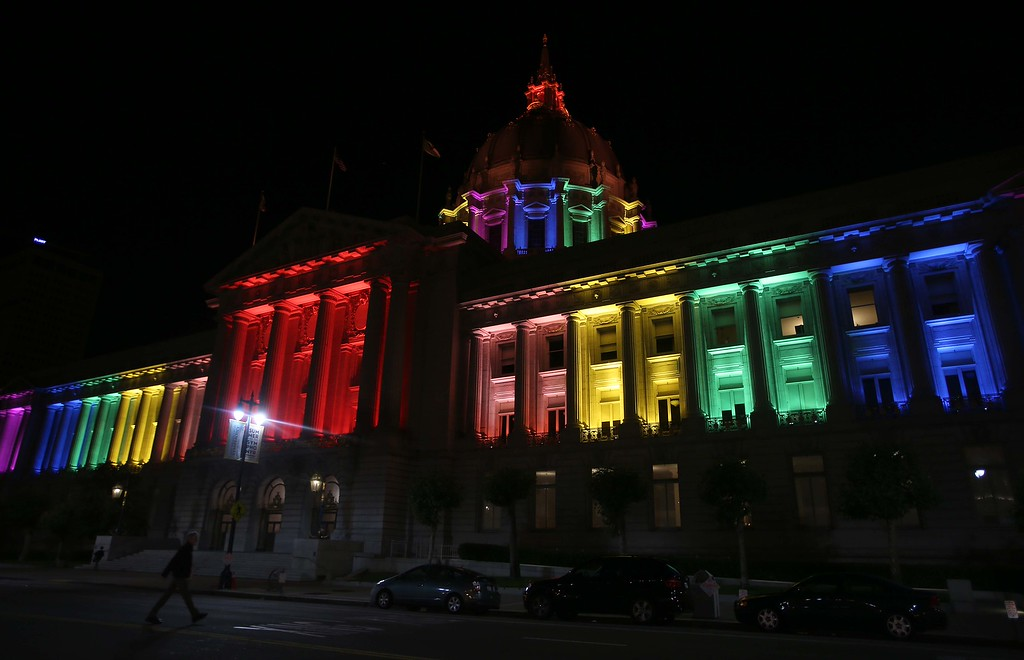 . San Francisco City Hall is lit in rainbow colors in San Francisco, Calif., on Wednesday, June 26, 2013. The U.S. Supreme Court dismissed California\'s Proposition 8 and declared the 1996 Defense of Marriage Act unconstitutional. This weekend marks the annual San Francisco Pride celebration. (Jane Tyska/Bay Area News Group)