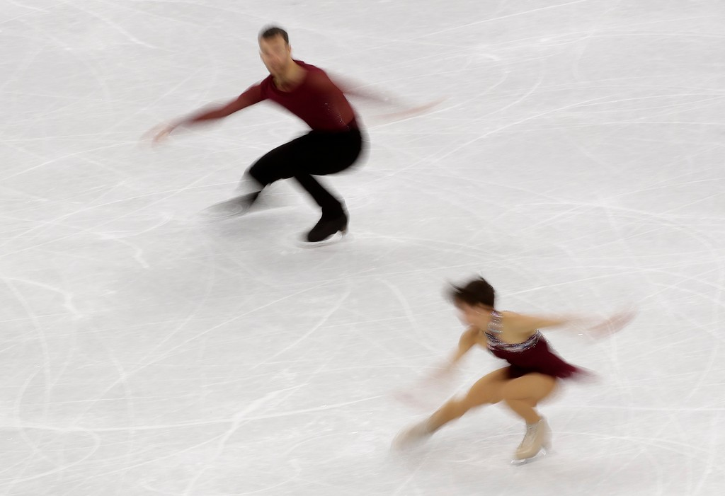 . Meagan Duhamel and Eric Radford of Canada perform in the pair skating team event in the Gangneung Ice Arena at the 2018 Winter Olympics in Gangneung, South Korea, Sunday, Feb. 11, 2018. (AP Photo/David J. Phillip)