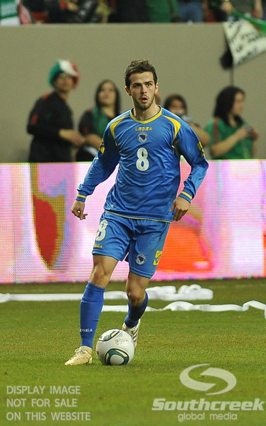 Mexico's Midfielder Israel Castro (#8) surveys the defense in Soccer action between Bosnia-Herzegovina and Mexico.  Mexico defeated Bosnia-Herzegovina 2-0 in the game at the Georgia Dome in Atlanta, GA.