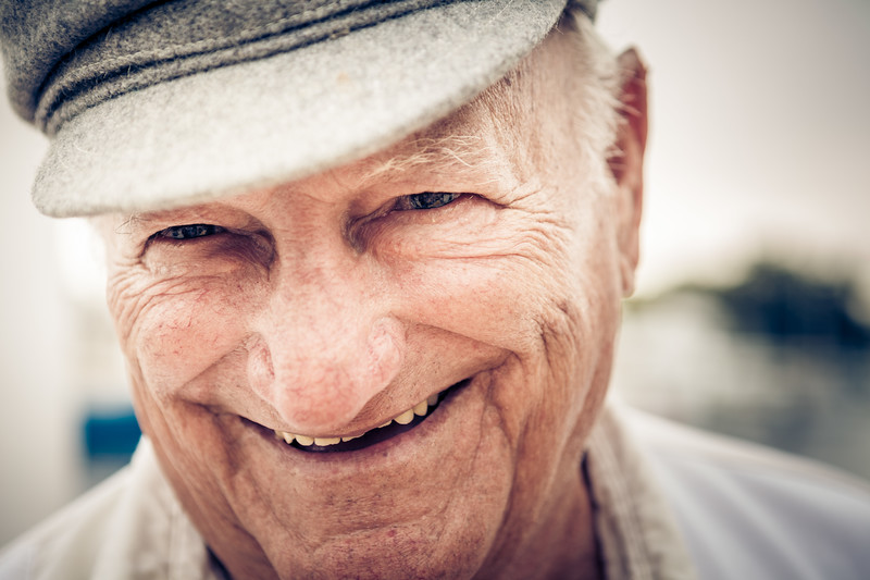 Closeup shot of an older man smiling.
