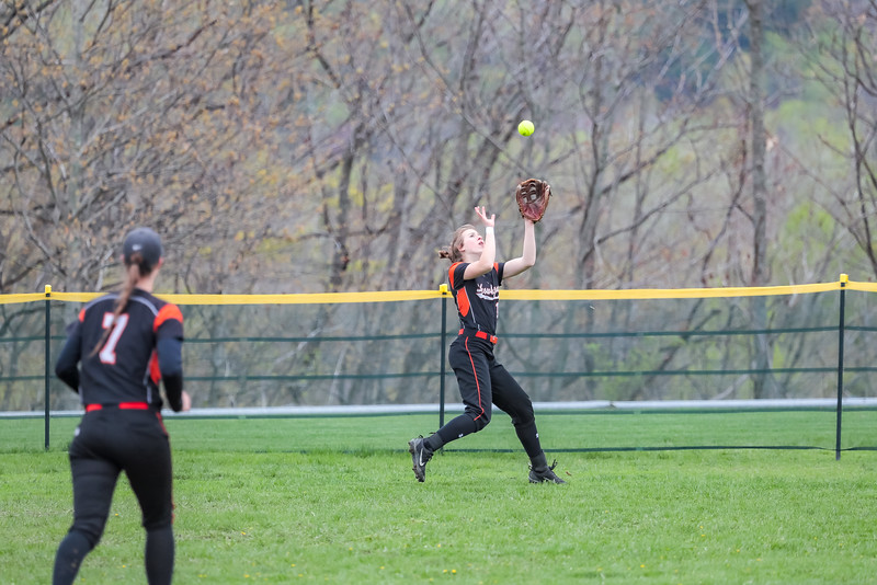 Skowhegan left fielder Annie Cooke makes an over-the-shoulder catch on a long fly ball.