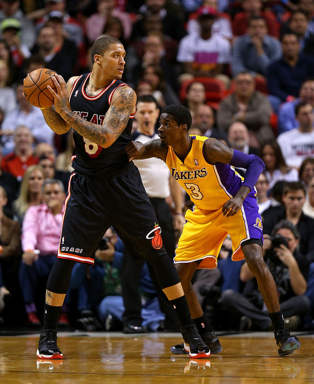 . Michael Beasley #8 of the Miami Heat posts up Manny Harris #3 of the Los Angeles Lakers during a game  at American Airlines Arena on January 23, 2014 in Miami, Florida.  (Photo by Mike Ehrmann/Getty Images)
