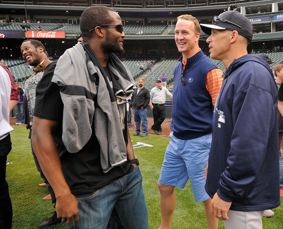 . Denver Broncos Champ Bailey (L) and Peyton Manning Talks with manager Joe Girardi (28) of the New York Yankees duringn batting practice May 7, 2013 at Coors Field. (Photo By John Leyba/The Denver Post)