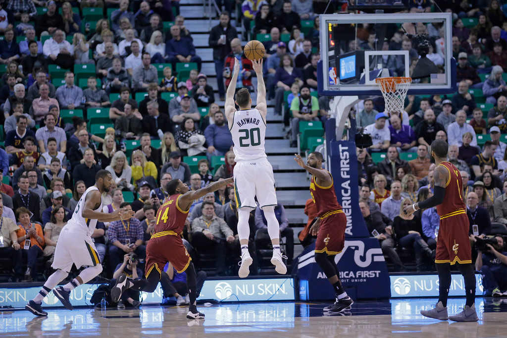 . Utah Jazz forward Gordon Hayward (20) shoots as Cleveland Cavaliers guard DeAndre Liggins (14) defends in the first half during an NBA basketball game Tuesday, Jan. 10, 2017, in Salt Lake City. (AP Photo/Rick Bowmer)