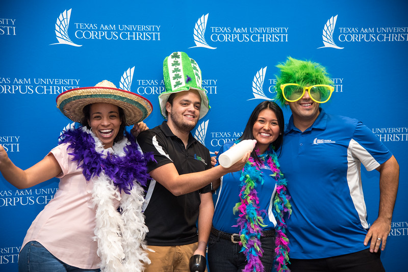 campus staff get together to pose with props at the Break in the Day event