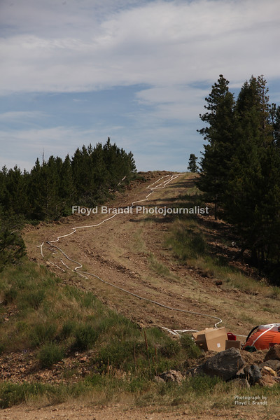 Havre Daily News / Floyd Brandt  A fire break that is finished Sunday Close to Zortmann complete with water and hose