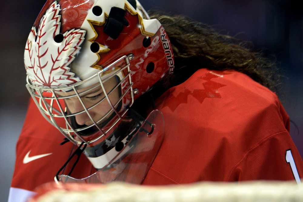 . Shannon Szabados (1) of the Canada takes a moment against the U.S.A. during the first period of the women\'s gold medal ice hockey game. Sochi 2014 Winter Olympics on Thursday, February 20, 2014 at Bolshoy Ice Arena. (Photo by AAron Ontiveroz/ The Denver Post)