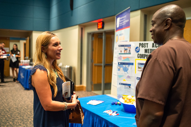 Nolan Pounds (right) answers Michele Enriquet's questions on applying for the Post Acute Medical in Corpus Christi as she gets ready to graudate the Fall of 2018.