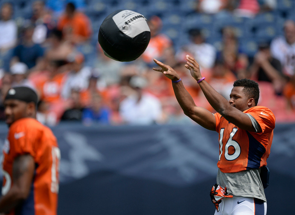 . Denver Broncos wide receiver Bennie Fowler (16) throws the medicine ball on day four of the Denver Broncos 2014 training camp July 27, 2014 at Sports Authority Field at Mile High. (Photo by John Leyba/The Denver Post)