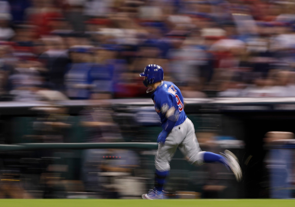 . Chicago Cubs\' Javier Baez rounds the bases after a home run against the Cleveland Indians during the fifth inning of Game 7 of the Major League Baseball World Series Wednesday, Nov. 2, 2016, in Cleveland. (AP Photo/Matt Slocum)