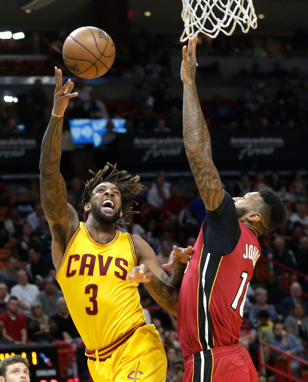 . Cleveland Cavaliers\' Derrick Williams (3) is fouled by Miami Heat\'s James Johnson (16) during the first half of an NBA basketball game, Saturday, March 4, 2017, in Miami. (AP Photo/Lynne Sladky)