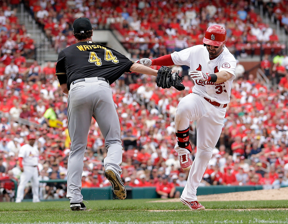 . St. Louis Cardinals\' Daniel Descalso (33) is tagged out along the firs baseline by Pittsburgh Pirates relief pitcher Tony Watson (44) in the seventh inning of Game 2 of baseball\'s National League division series on Friday, Oct. 4, 2013, in St. Louis.  (AP Photo/Jeff Roberson)