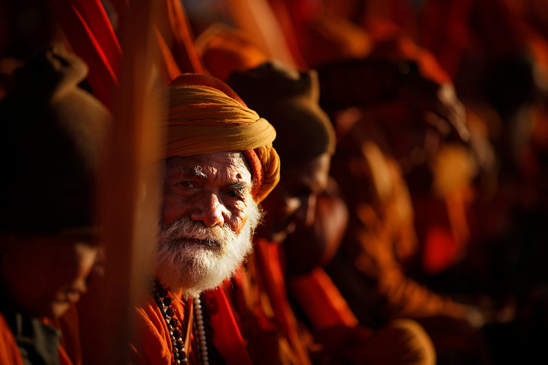 ". Hindu holy men belonging to  ""ekadandi\"", or single staff holding sect of Hindu holy men, waits for charitable food and money during the Maha Kumbh festival in Allahabad, India, Monday, Jan. 28, 2013. Millions of Hindu pilgrims are expected to attend the Maha Kumbh festival, which is one of the world\'s largest religious gatherings that lasts 55 days and falls every 12 years. The \""ekadandis\"" are an ancient sect of traveling renunciates belonging to the Vaishnavite sect. (AP Photo/Saurabh Das)"