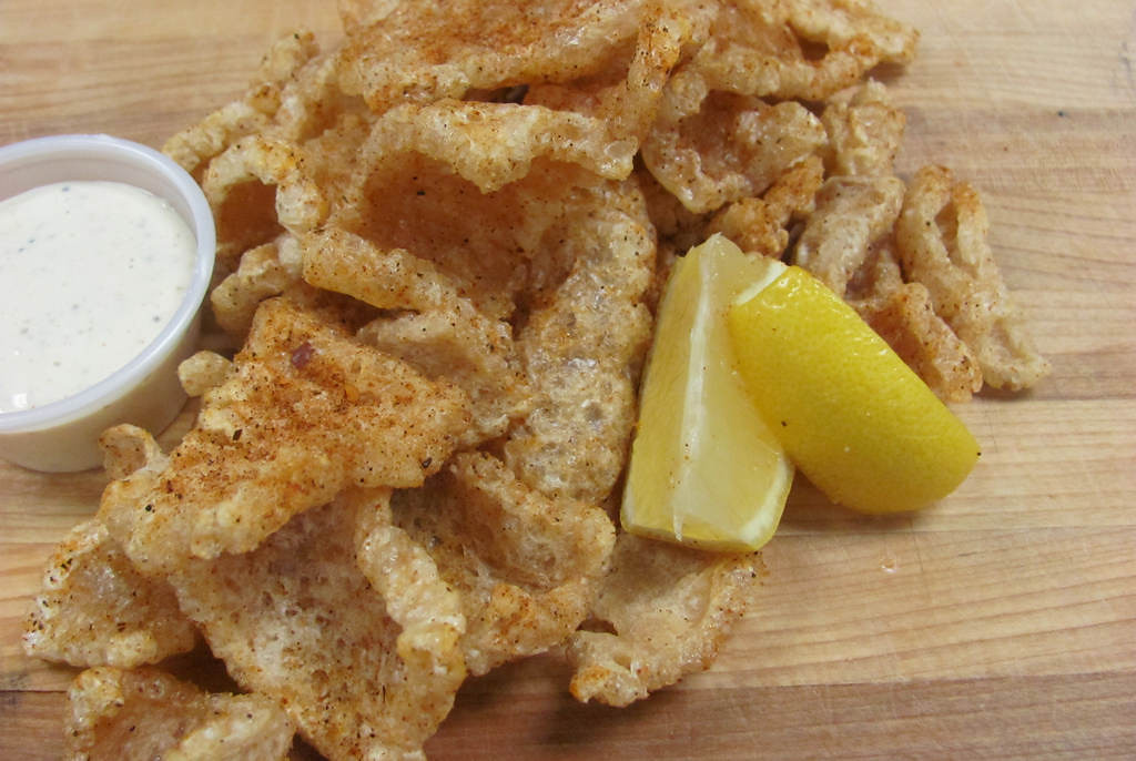 . Cajun Pork Rinds --  Flash-fried pork skins dusted with Cajun seasonings and served with lemon and Alabama-White BBQ sauce. Available at Famous Dave\'s, located near the corner of Dan Patch Ave. and Liggett St. Photo courtesy of the Minnesota State Fair.