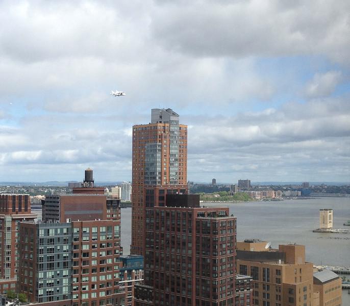 Space shuttle flying past my office window