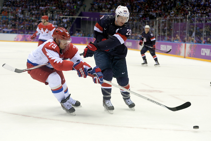 . Ryan Suter (20) of the U.S.A. and Andrei Markov (79) of the Russia vie of the puck during  the U.S.A.\'s shootout-win at Bolshoy arena. Sochi 2014 Winter Olympics on Saturday, February 15, 2014. (Photo by AAron Ontiveroz/The Denver Post)
