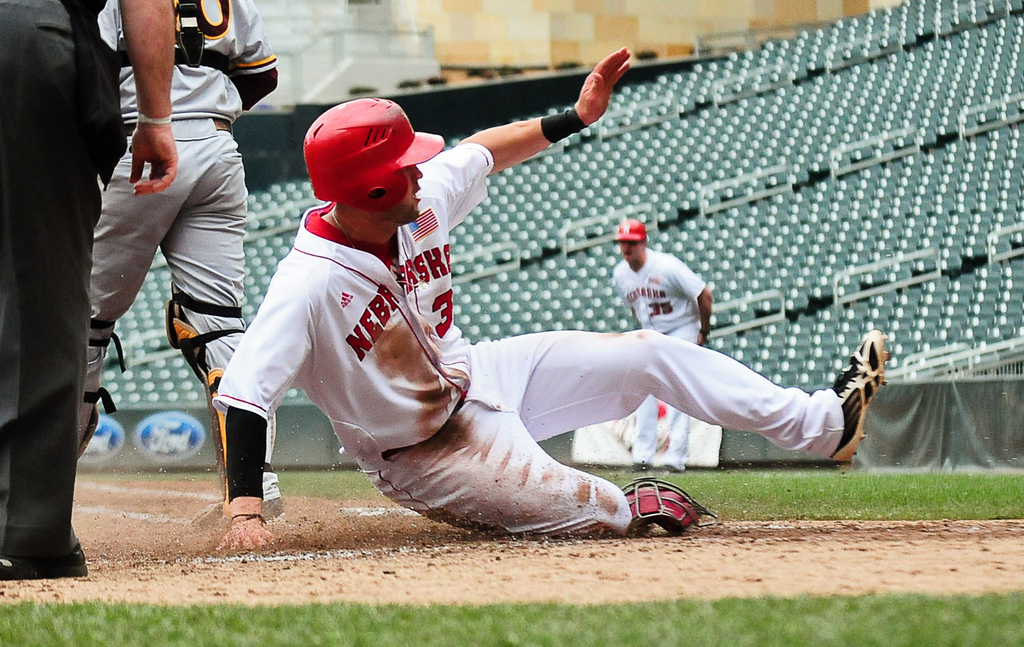 . Nebraska\'s Kash Kalkowski slides home to score in the fourth inning. (Pioneer Press: Ben Garvin)