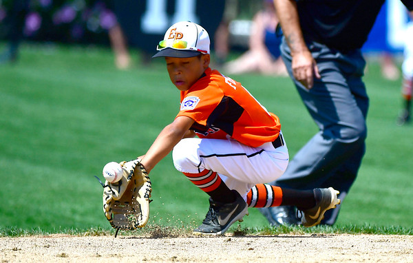 8/4/2019 Mike Orazzi | Staff East Pennsboro Little League's Eric Foster Jr (8) during their opening round game of the Little League Mid-Atlantic regional Baseball Tournament in Bristol.