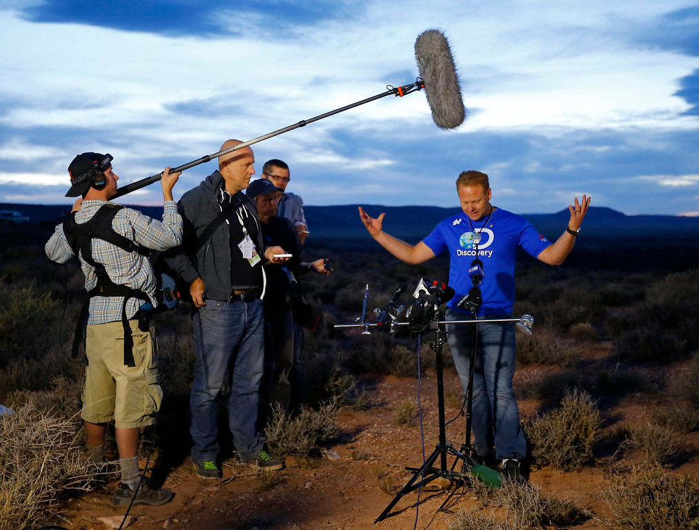 . Daredevil Nik Wallenda gestures during a news conference after completing a high-wire walk on a two-inch (5-cm) diameter steel cable rigged 1,400 feet (426.7 metres) across more than a quarter-mile deep remote section of the Grand Canyon near Little Colorado River, Arizona June 23, 2013. REUTERS/Mike Blake