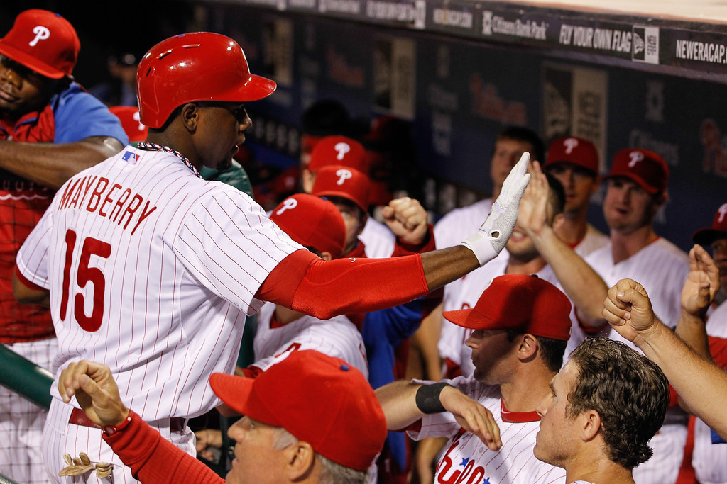 . John Mayberry Jr. #15 of the Philadelphia Phillies is congratulated by teammates after hitting a three run home run in the fourth inning of the game against the Colorado Rockies  at Citizens Bank Park on August 19, 2013 in Philadelphia, Pennsylvania. (Photo by Brian Garfinkel/Getty Images)