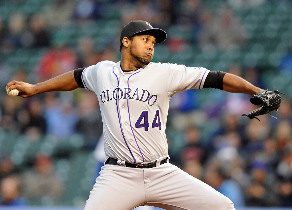 . Colorado Rockies\' Juan Nicasio (44) pitches against the Chicago Cubs during the first inning of a baseball game Monday, May 13, 2013, in Chicago. (AP Photo/Jim Prisching)