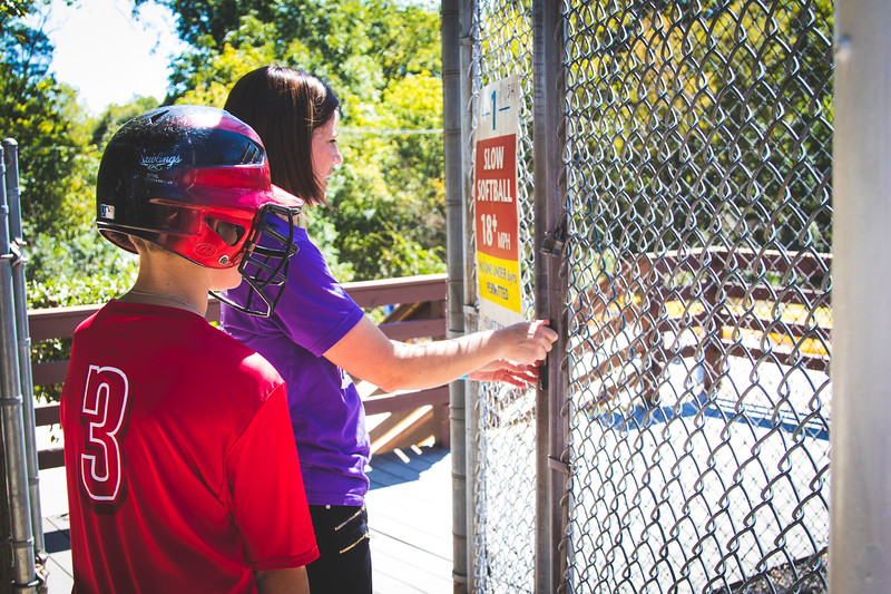 Mom Son at batting cage gate_8908.JPG