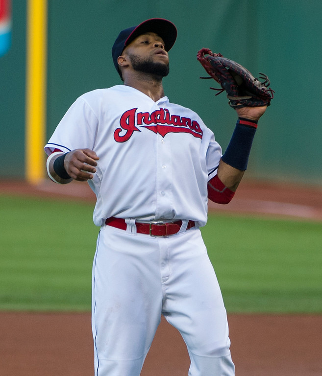 . Cleveland Indians first baseman Carlos Santana catches a pop fly by Toronto Blue Jays; Edwin Encarnacion during the first inning of a baseball game in Cleveland, Friday, Aug. 19, 2016. (AP Photo/Phil Long)