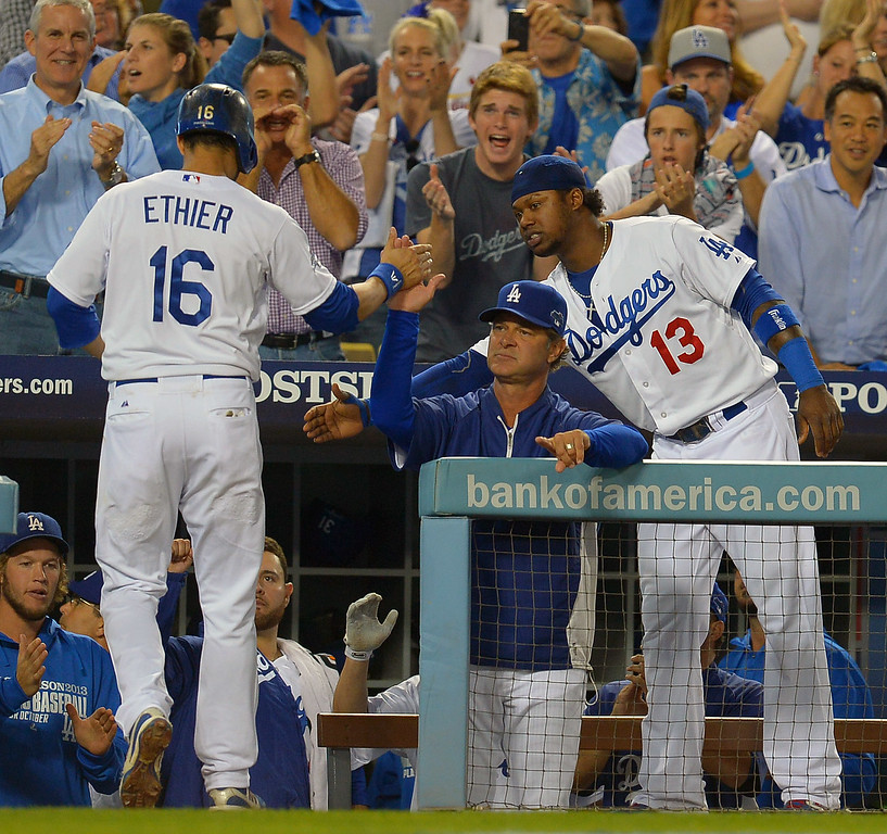 . The Dodgers\' Andre Ethier enters the dugout after scoring in the 4th against the Cardinals during game 4 of the NLCS at Dodger Stadium Tuesday, October 15, 2013. (Photo by Andy Holzman/Los Angeles Daily News)