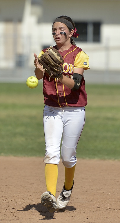 . LONG BEACH, CALIF. USA -- Wilson\'s Kori Cochran (11) drops the fly ball against Lakewood in Lakewood, Calif., on May 2, 2013. If Cochran had held on to the ball the inning would have been over, instead Lakewood went on to score more runs.  Photo by Jeff Gritchen / Los Angeles Newspaper Group