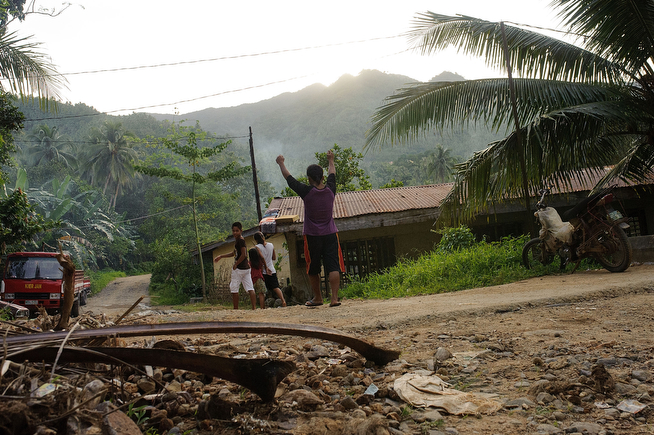 . A gold miner celebrates the end of a work day as he walks towards his home, on April 22, 2014 in Pinut-An, Philippines. (Photo by Luc Forsyth/Getty Images)