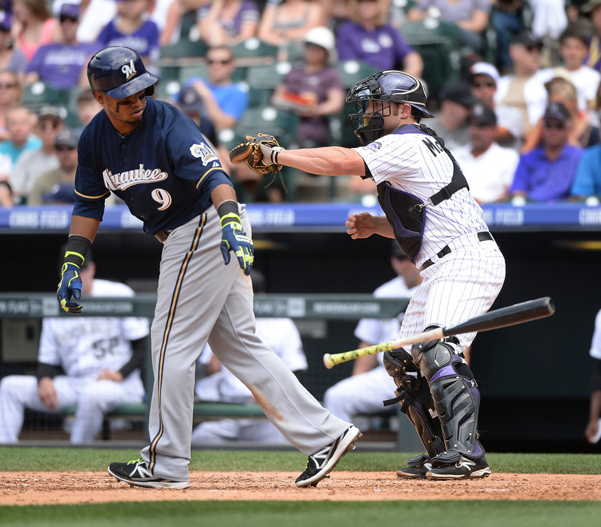 . DENVER, CO - JUNE 21: The Rockies intentionally walked Milwaukee batter Jean Segura in the third inning. Segura scored on a wild pitch and error that cleared the bases. The Colorado Rockies hosted the Milwaukee Brewers at Coors Field Saturday afternoon, June 21, 2014. Photo by Karl Gehring/The Denver Post