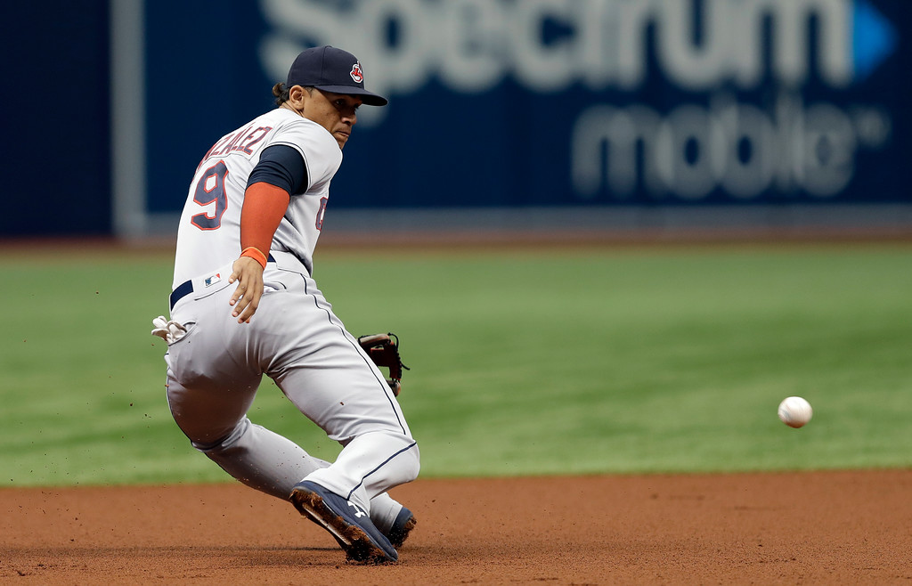 . Cleveland Indians third baseman Erik Gonzalez (9) can\'t stop a single by Tampa Bay Rays\' Tommy Pham during the first inning of a baseball game Wednesday, Sept. 12, 2018, in St. Petersburg, Fla. (AP Photo/Chris O\'Meara)